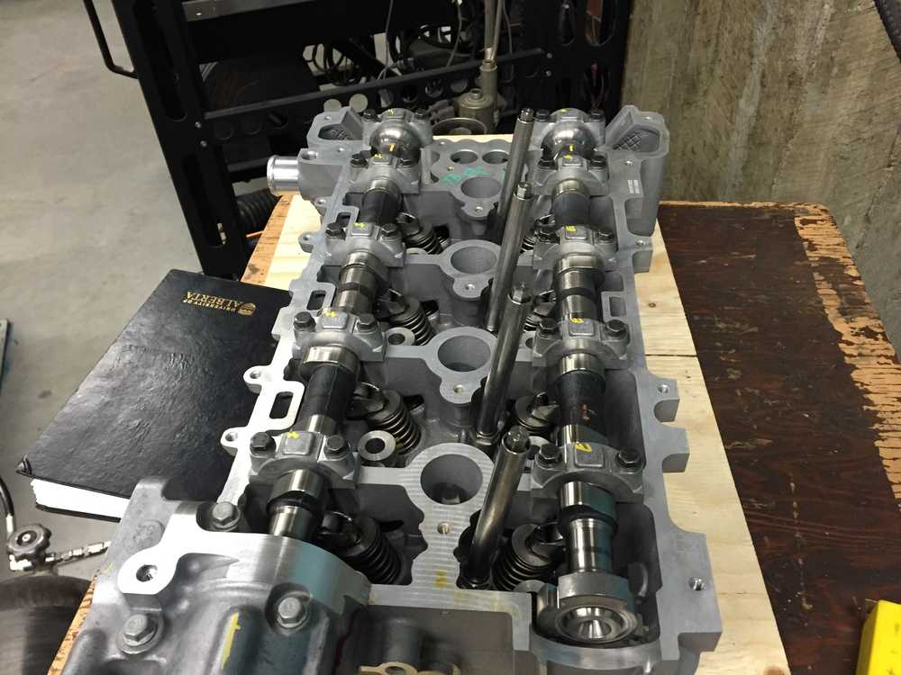 Top of new cylinder head with valve cover removed.