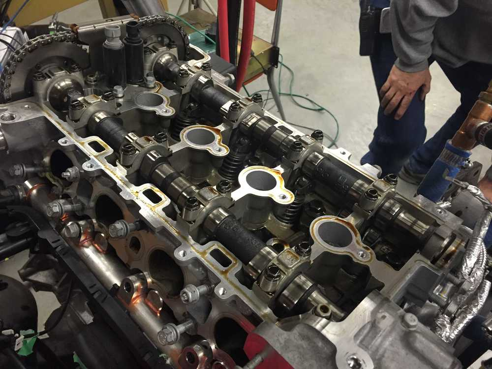 Valve cover removed from cylinder head.