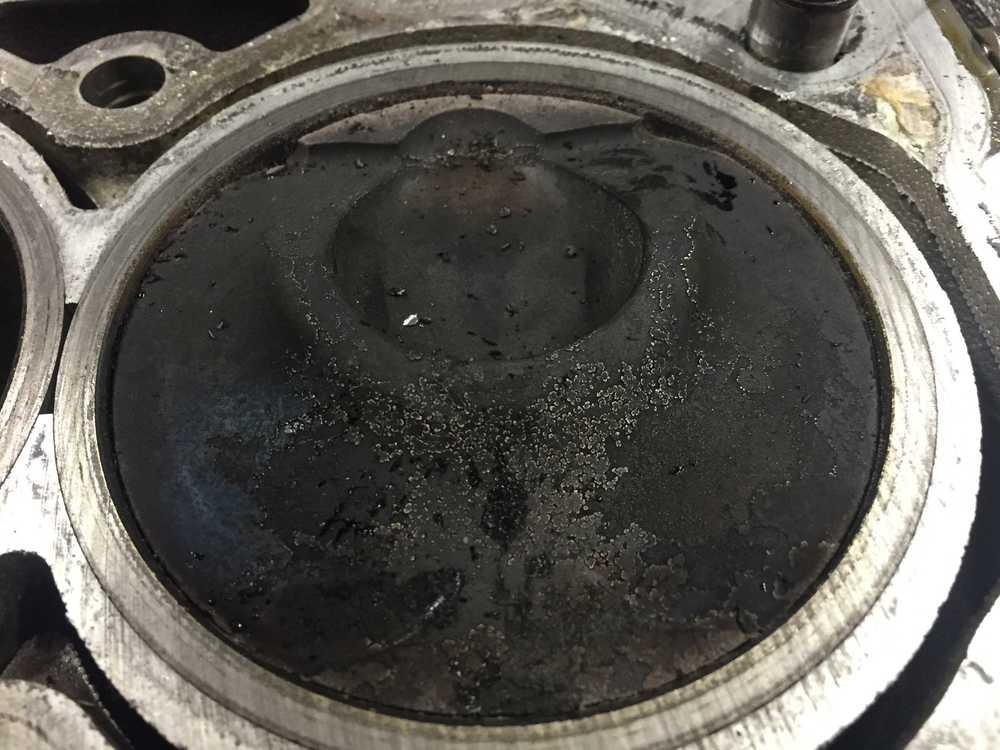 Piston head showing valve groves.