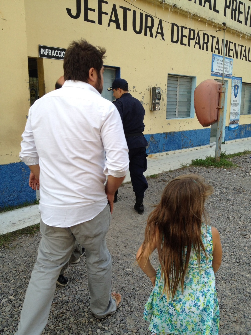 Javier Mendoza with his daughter on a tour of the Honduran National Police station in La Ceiba Honduras
