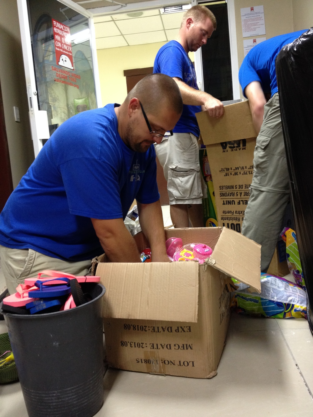 July Team Member Loren sorting through donations.