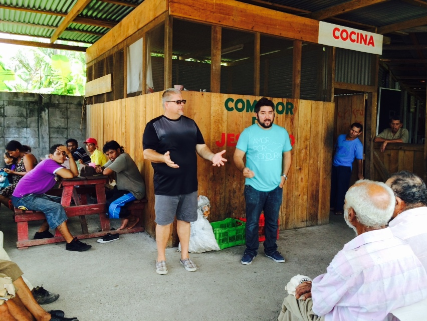 Pastor Donny Kyker of Odessa, and Javier Mendoza of Connect Global speaking to the guests of Comedor de JesuCristo in La Ceiba.