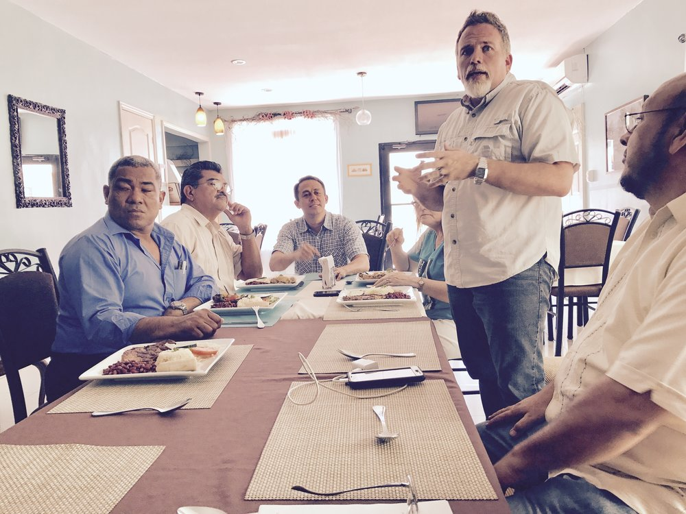 Travis Moffitt sharing his heart, and vision with leaders of the Pastor's Association of La Ceiba. In attendance: Edgardo Lianes - Pastor of The Church of the Nations, Ricardo Jimenez - President of the Pastor's Association, & Francisco Arrandas - Vice President of the Pastor's Association and Pastor of Kairos Church, along with Pastor Allan Lorenzana of CCI Church La Ceiba, Dr Mitch Arbelaez of Go To Nations, and Dr Johnny and Betty Moffitt of Worldwide Voice In the Wilderness.