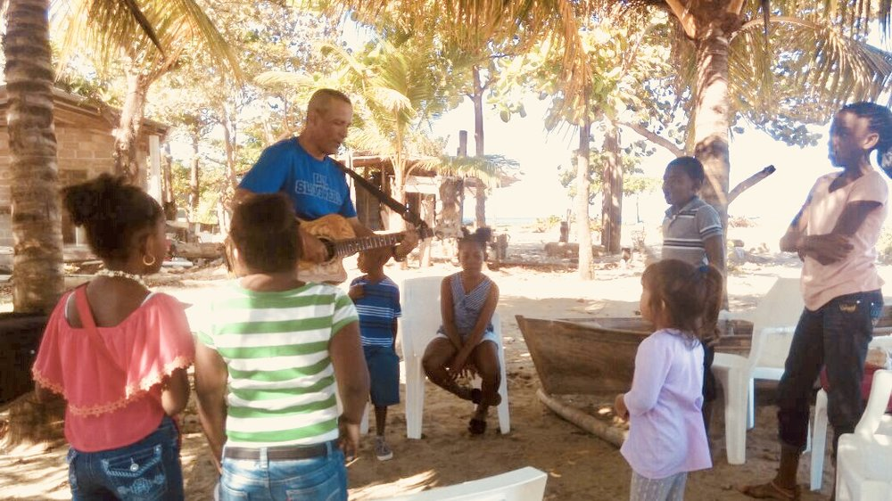 Pastor Nahun Flores offering his gift of worship and his love for one another to children in Trujillo Honduras.