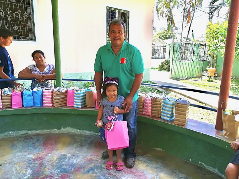 Connect Global National Director in Honduras, Jorge Amador, sharing Easter baskets with the Kids from Little Lambs Refuge in La Masica, Honduras is seen here with his daughter, Allison.