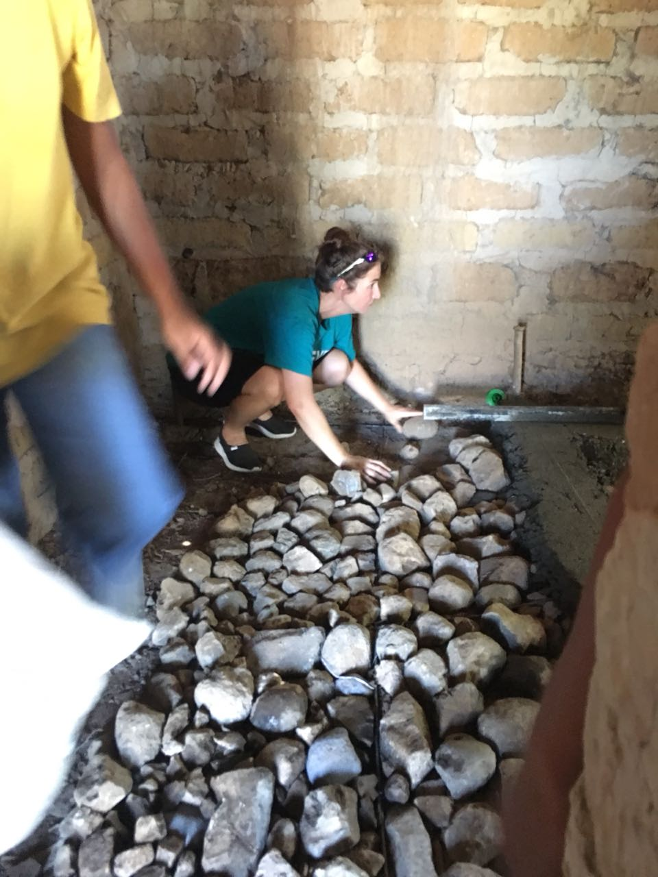 Part of the Connect Global August team focus was to pour brand new concrete floors for families in need.