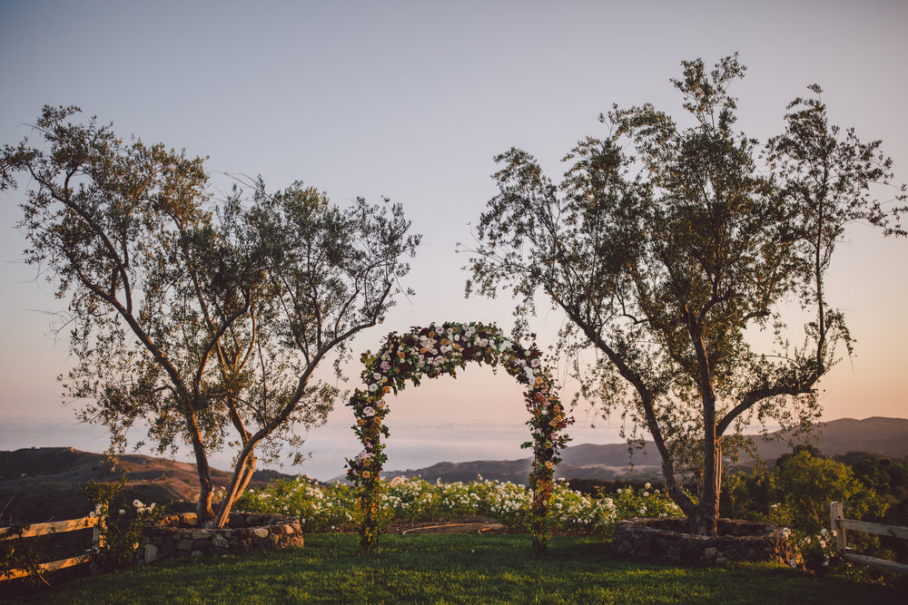romantic-boho-stonewall ranch-malibu-sunset-ceremony-floral arch