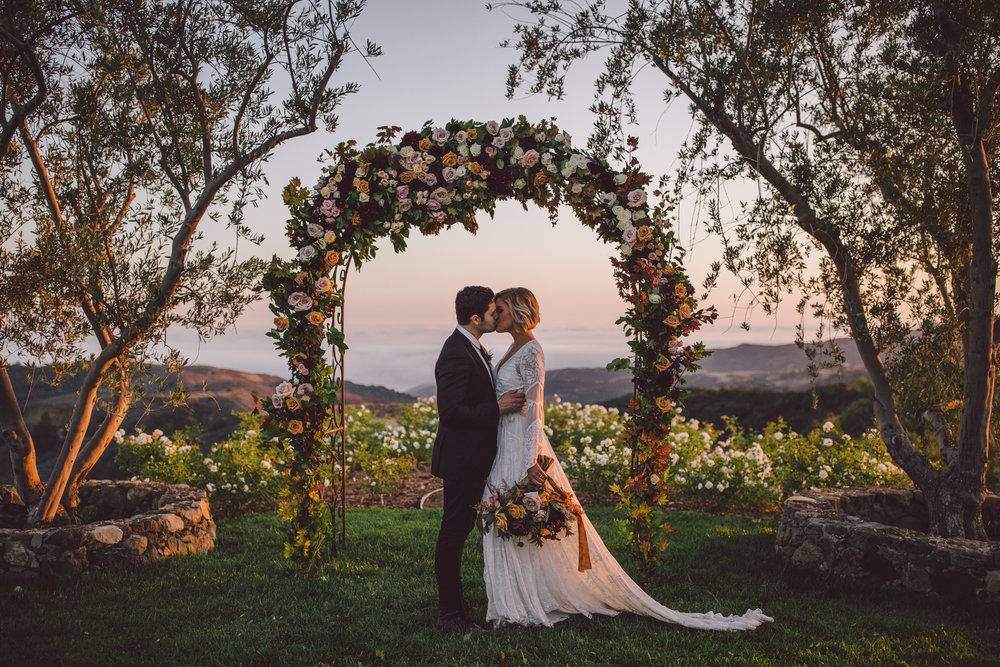 sunset-ceremony-flower arch-malibu-stonewall ranch-boho