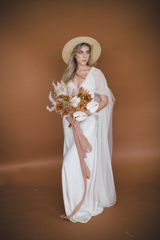bride straw hat simple bohemian dress bouquet floral sienna fall