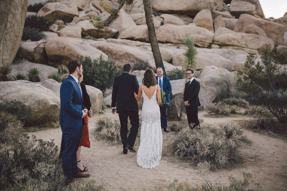 joshua tree elopement ceremony prayer bohemian bride