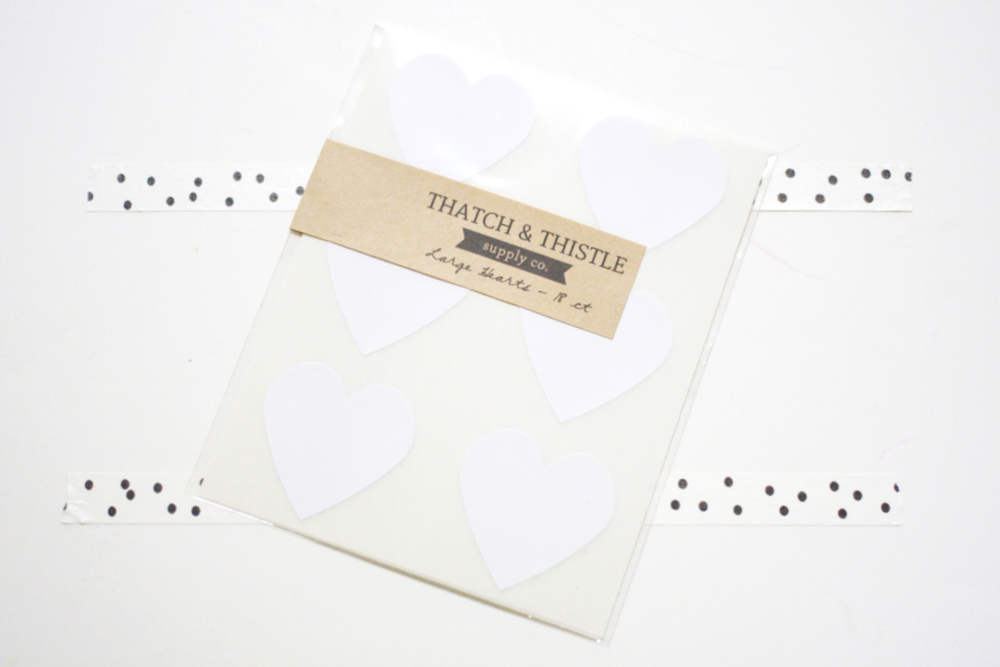 Packaging and party decor shop, Thatch & Thistle, contributed packs of heart stickers in different colors.