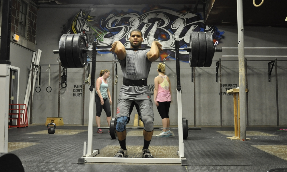 Coach Cory Price on his way to setting a new Front Squat PR