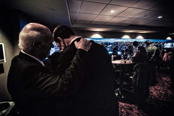 Lou Lamoriello embraces Joe Nieuwendyk at Prudential Center, Dec. 2011