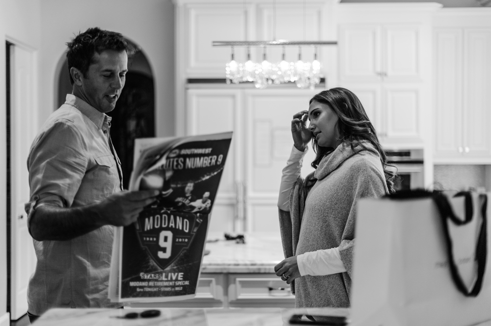 Mike shows his wife, Allison Modano, a feature story that ran in the Dallas Morning News the day of his number retirement ceremony.