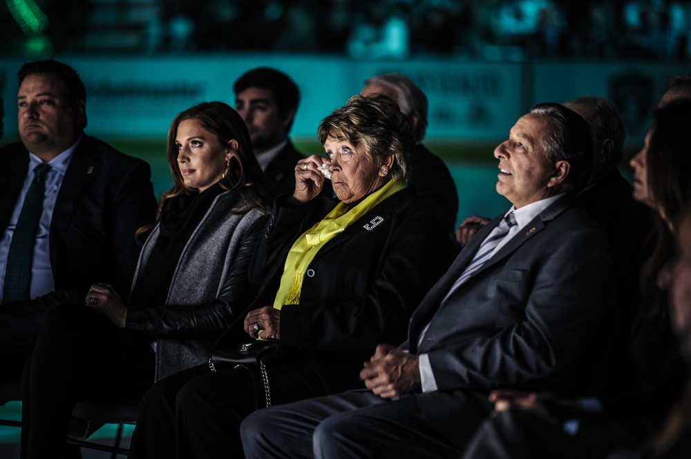Karen Modano wipes tears away as her son's heartfelt thanks to his parents sacrifice brings the 19,000 fans to their feet.
