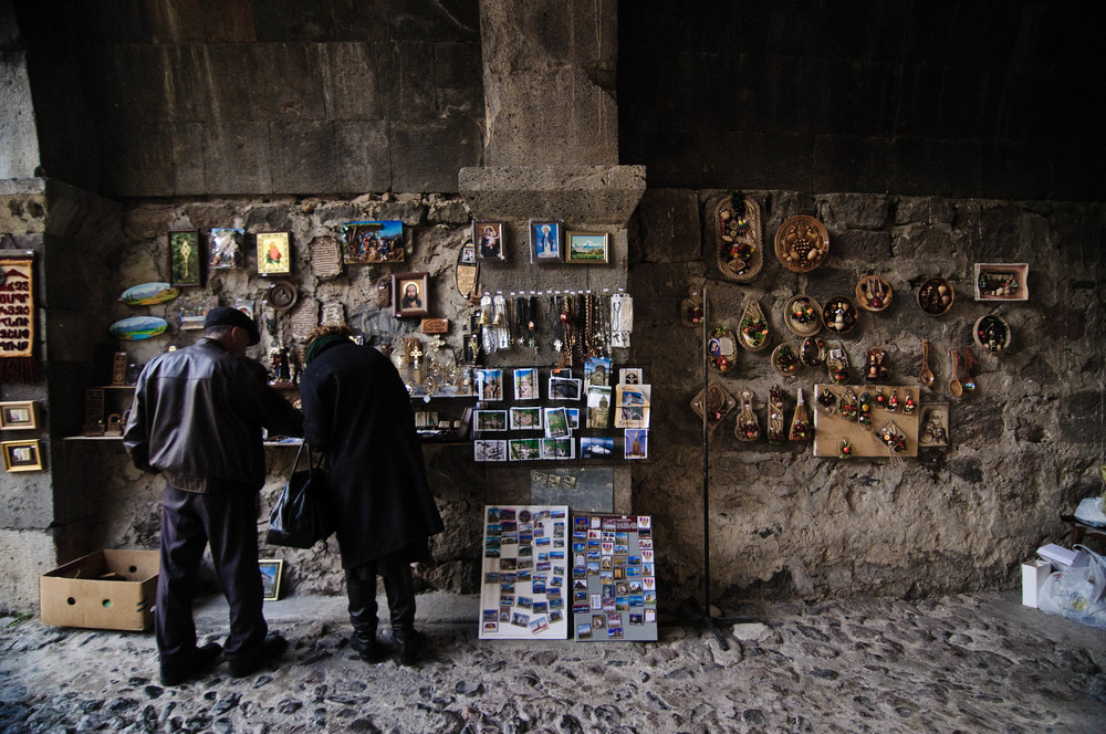 Tourists browse the gift shop at the entrance to Gerhardt, a 4th century cave church.