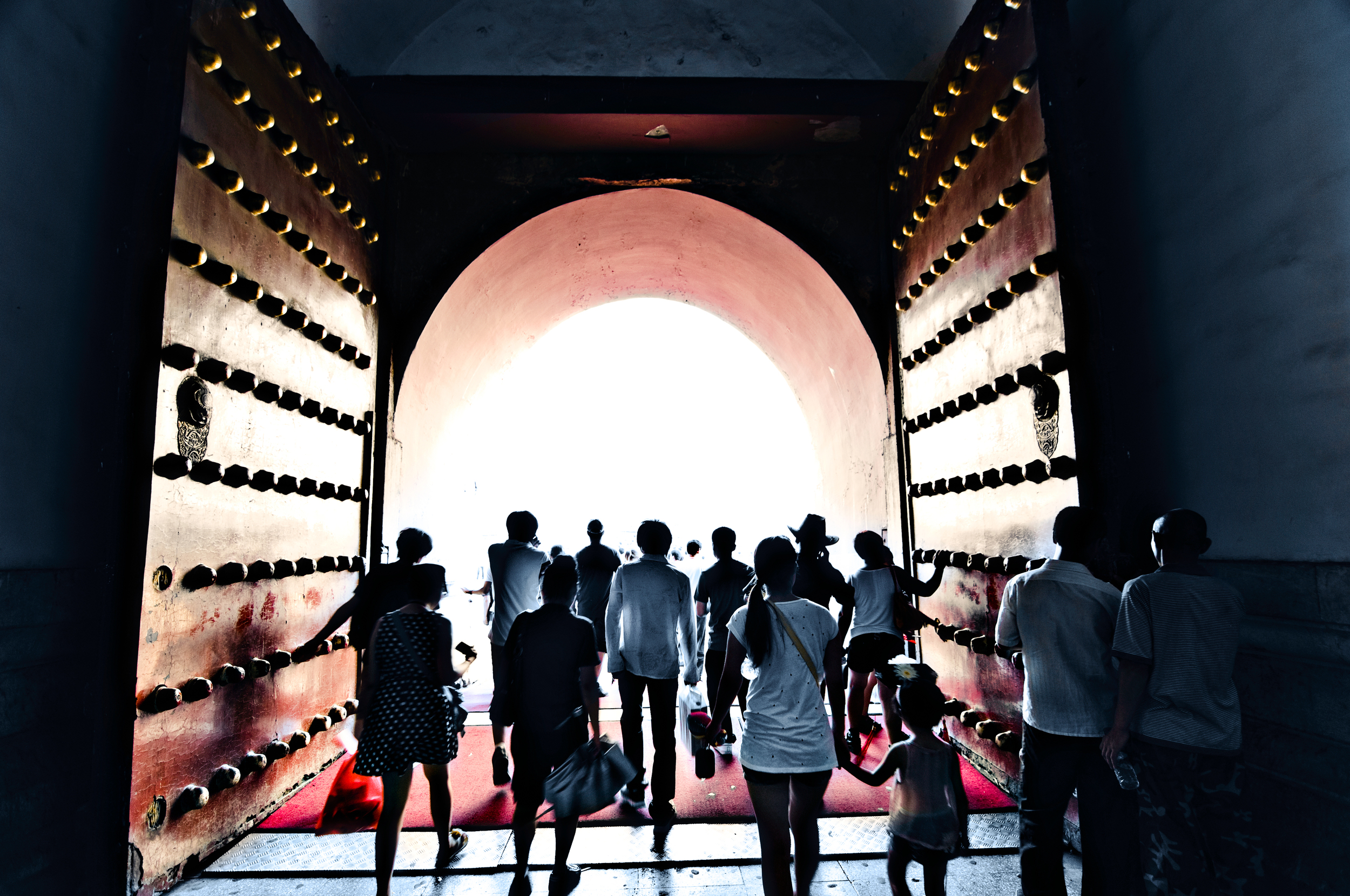 Visitors to the Forbidden City , in Beijing, exit through the central doors  of Wumen
