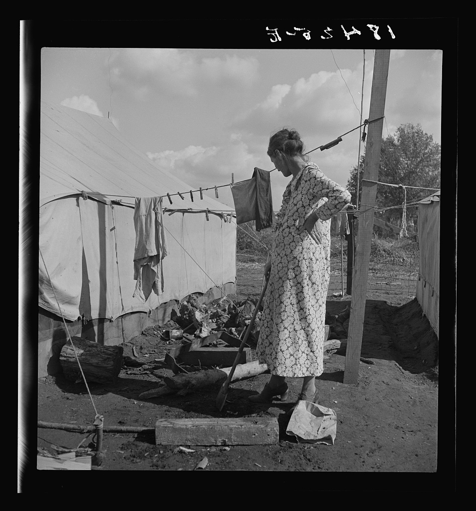 Women in auto camp for migrant citrus workers. Tulare County, California.