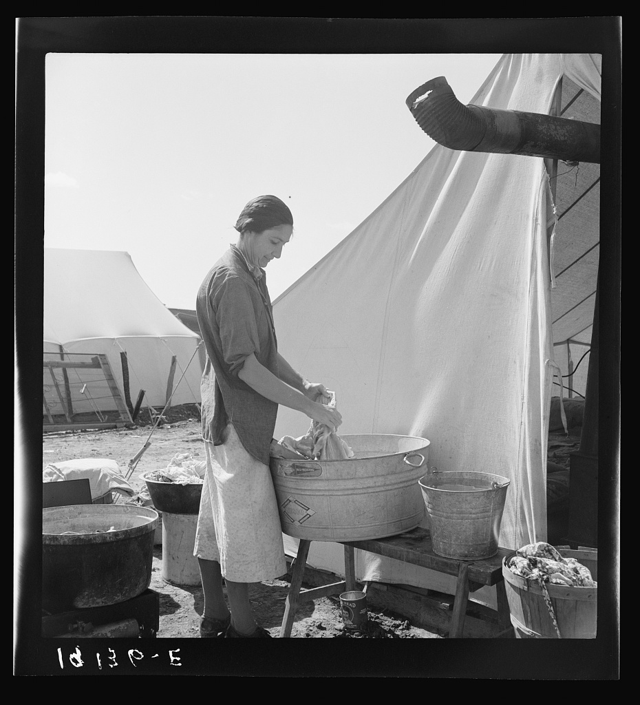 "Pea picker camp. This family had been farm owners in Oklahoma, lost their farm and for the last three years ""have been draggin' our children around California. We're a have-to case."" Calipatria, Imperial Valley, California."
