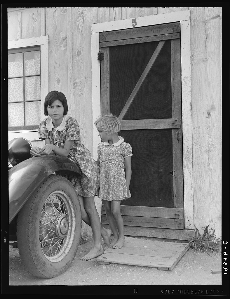 Greenfield, Salinas Valley, California. An Arkansawyers auto camp filled almost completely with migrants from Arkansas. Rent ten dollars a month for one room, iron bed, electricity. Rough board walls with cracks. This community is subject of a study by BAE Regional Office, Berkeley, California.