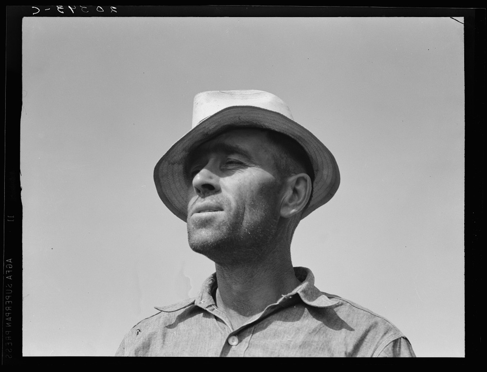 "Washington, Yakima Valley, near Wapato. Rural rehabilitation client (Farm Security Administration). Portrait of Chris Adolf. ""My father made me work. That was his mistake, he made me work too hard. I learned about farming but nothing out of the books."""