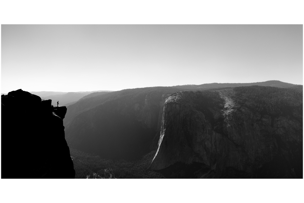 Brendan, 14, stands on the diving board at Taft Point, overlooking El Capitan and the Yosemite Valley.