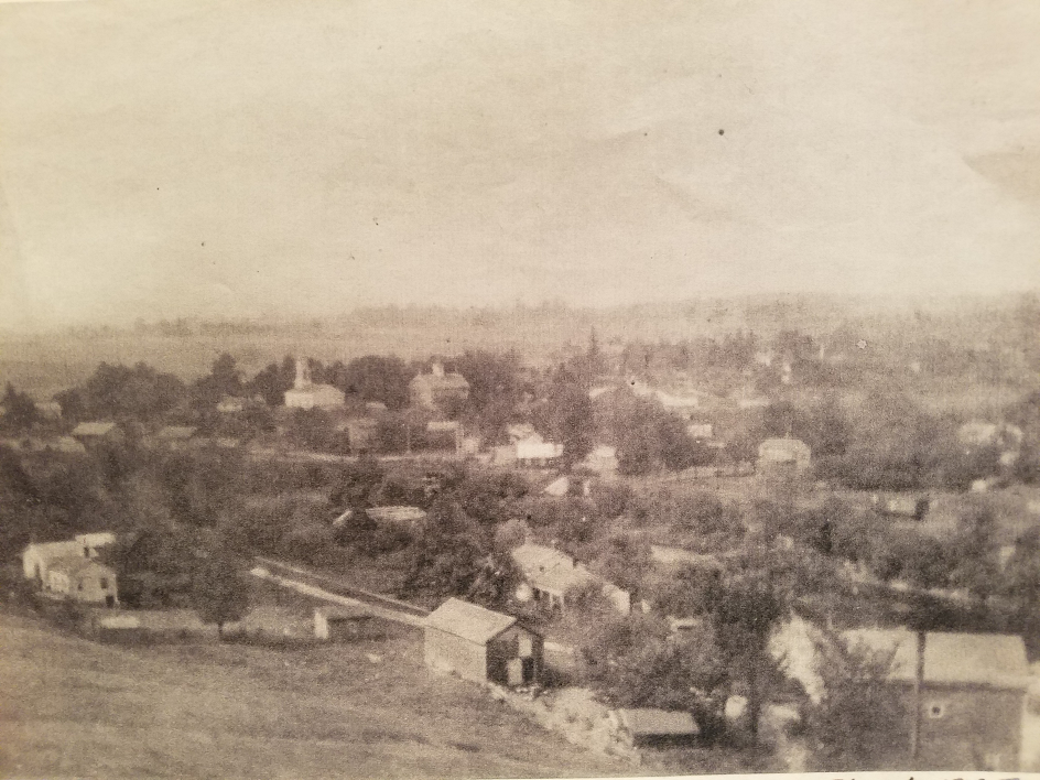 The village of Orleans, circa 1895. The school is seen in the center of the photo, immediately to the right of the white church.