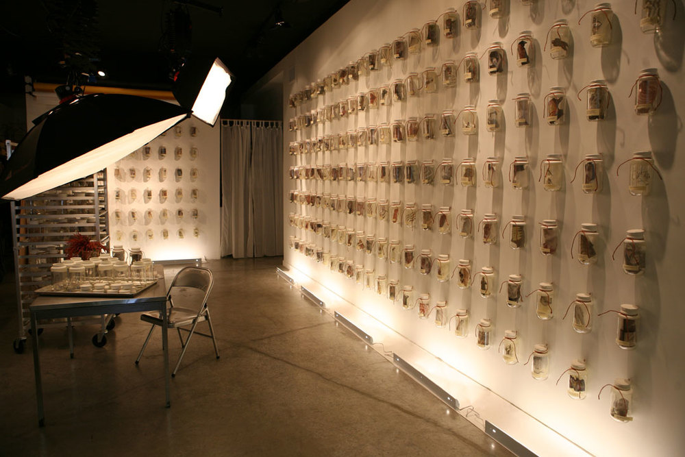 "Photography studio (with ""What's on Your Mind"" Installation hanging in it)"