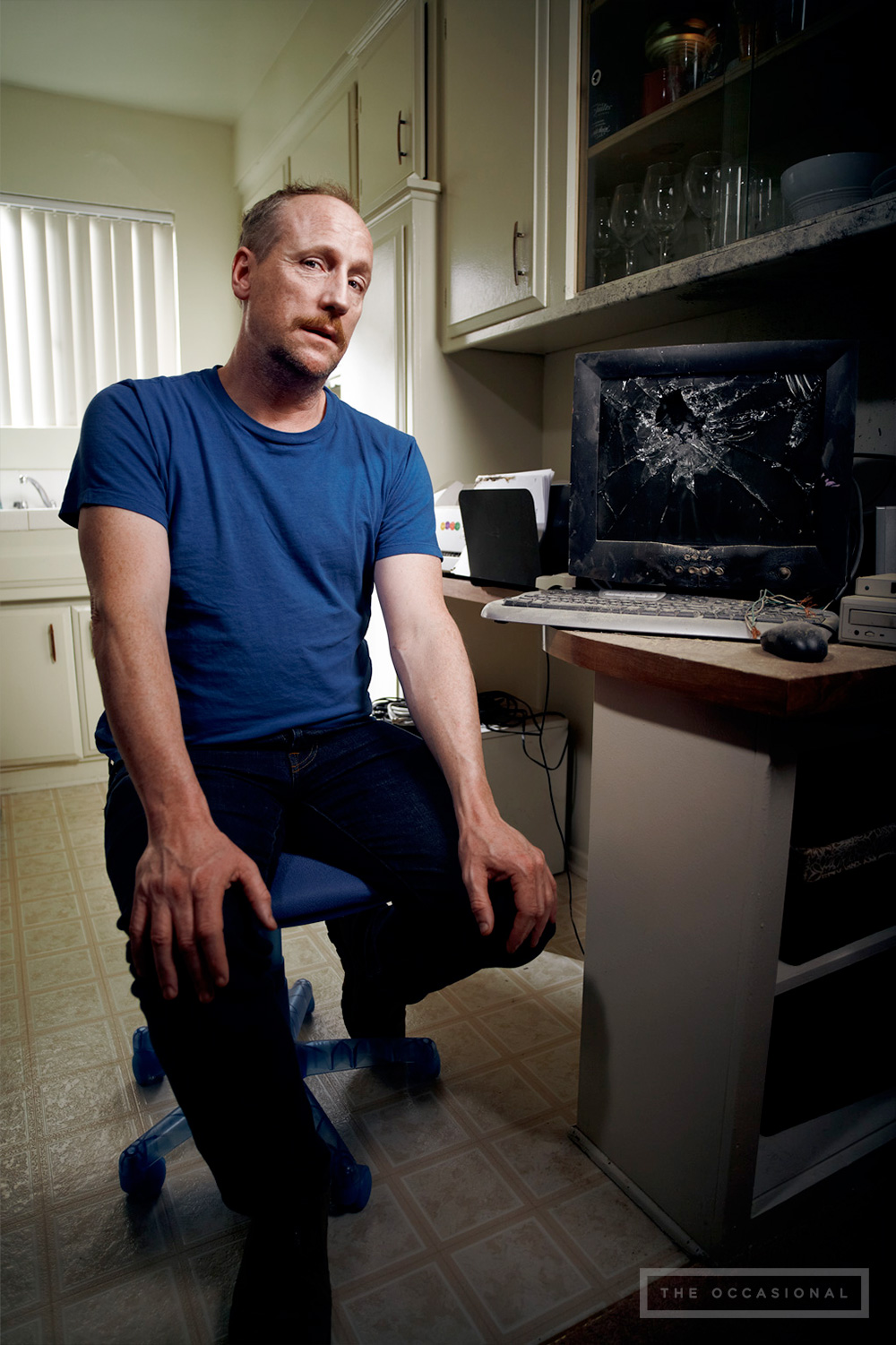 "White in front of his ill-fated computer, which sits atop a desk still covered in soot. ""Not a day goes by that I don't unplug it and plug it back in, hoping it will restart,"" White confided. ""Alas, that wasn't in Y2K's plans."""