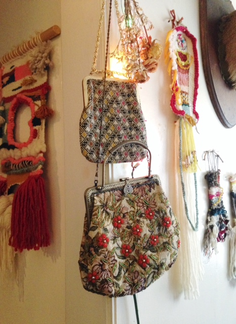 Vintage woven and beaded bags I've collected, paired with Christmas lights and my wall hangings. I'm slightly nostalgic.