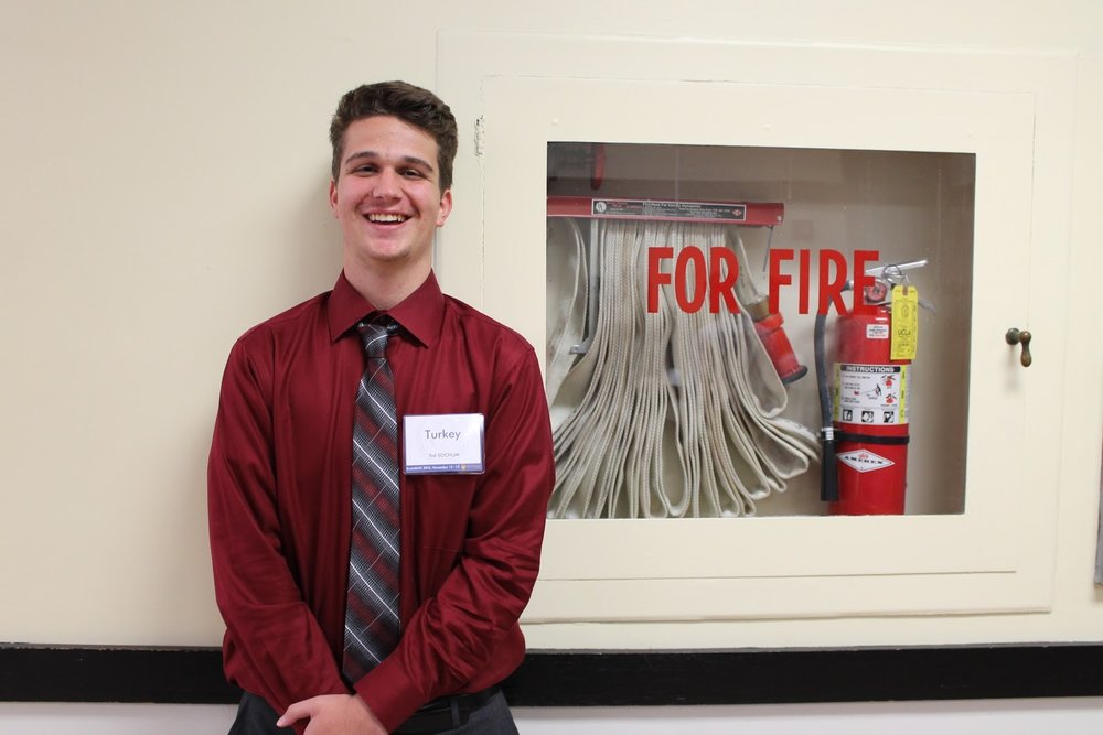 This delegate's outfit game was on fire, good thing he was conveniently standing next to a fire extinguisher.