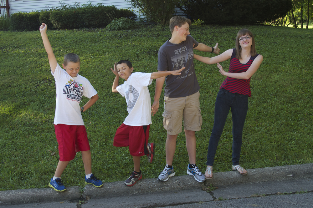 Whenever we pose the kids for the first day of school photo (and most other times, too), we end with something goofy. This is what we got. This probably represents who they are better than standing up straight and smiling!