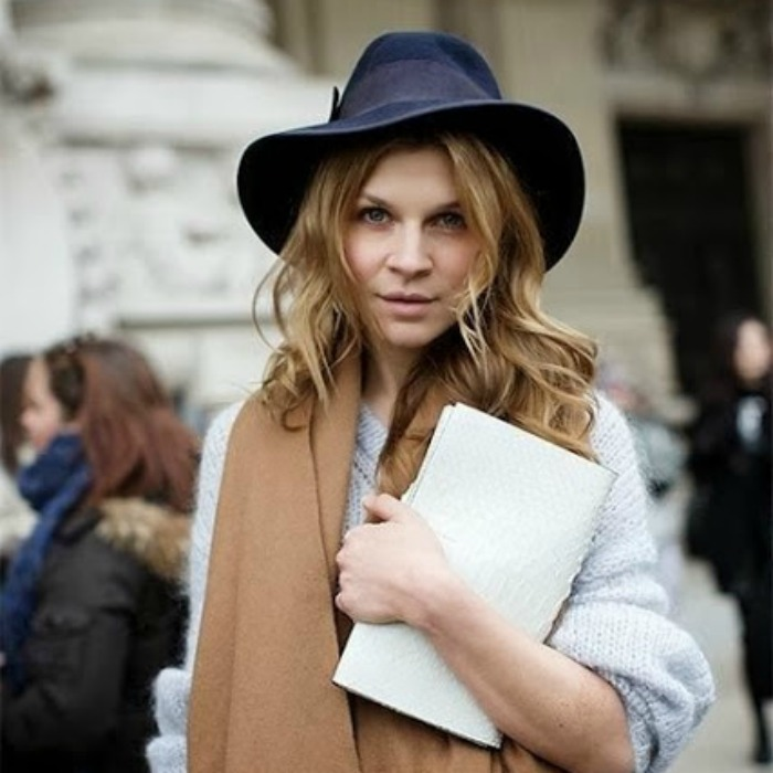 Here is Clémence Poésy — of Harry Potter fame — looking effortlessly chic in a navy fedora and caramel scarf.