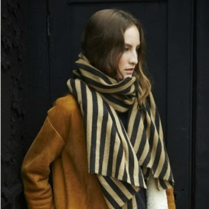 Stripes are almost always a good idea, especially with a camel shearling coat.