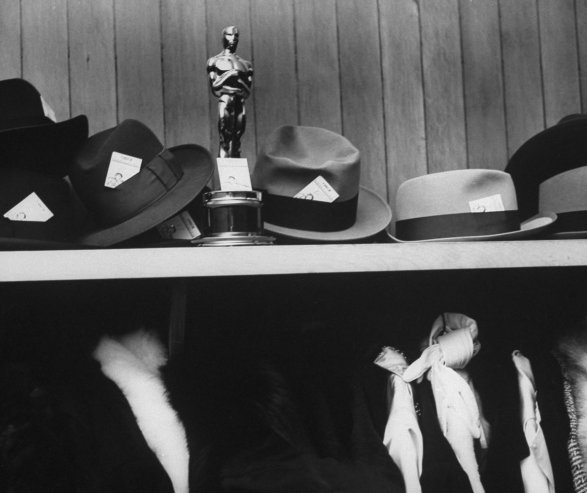 Producer Buddy Adler's Academy Award in coat check at the 1954 Oscar's after party