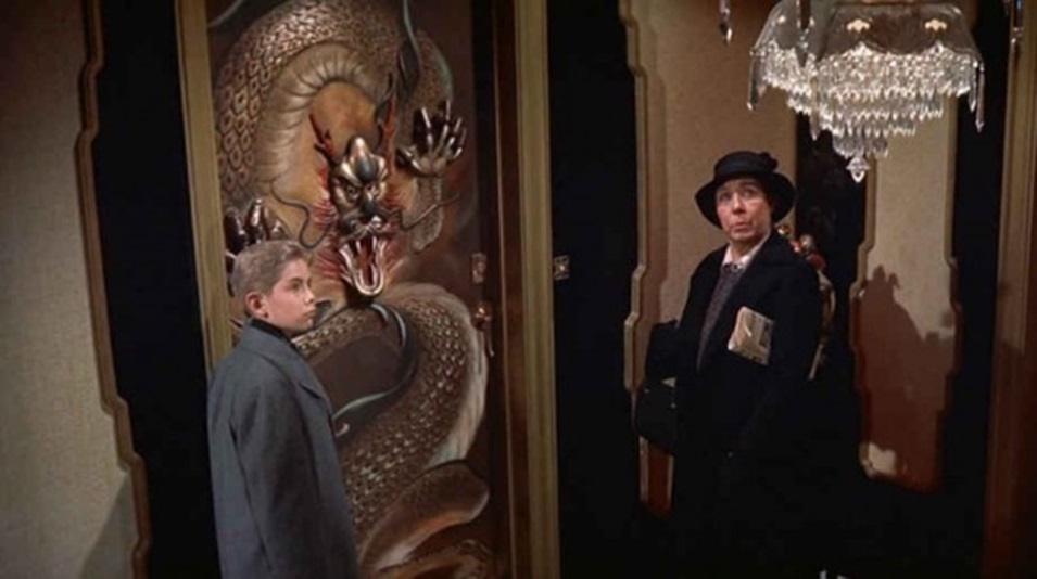 Patrick and his nanny, Nora are greeted upon their arrival by a hallway that Nora describes as looking like 'the Ladies Room at the Oriental Theater', which includes a sculpted dragon door that has smoke coming from its nostrils and eyes that move.