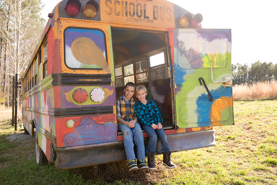 Newnan-Family-Photographer-boys-posing-in artsy-school-bus