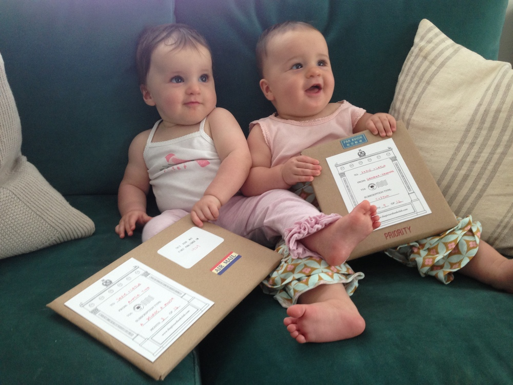 Sadie & Layla (aged 10 months) were given the Decade-A-Month subscription by a friend at their mother's baby shower. Their grandparents also bought them a custom subscription when they were born and requested books featuring twins.