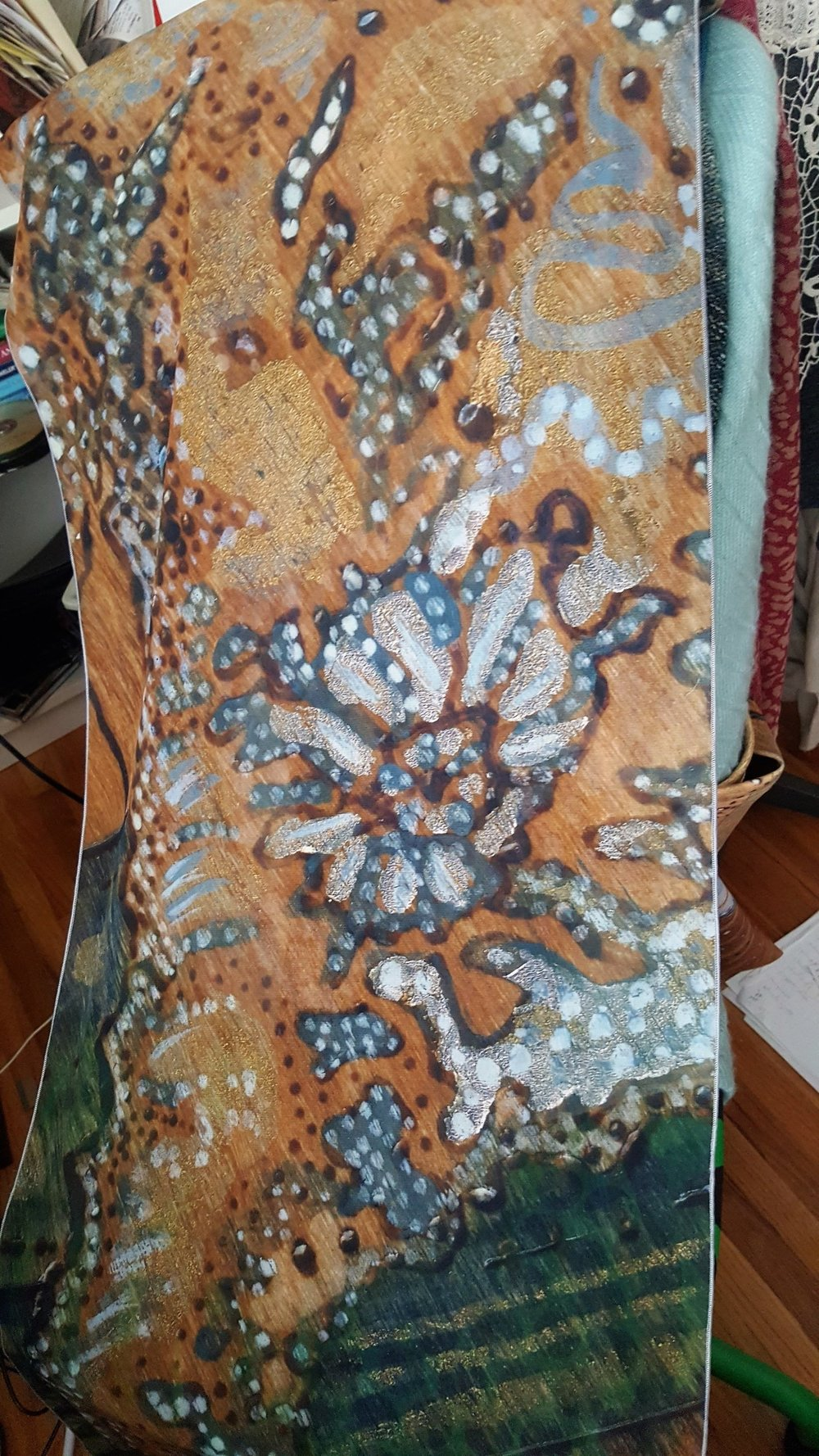 This is a poly chiffon scarf. The fabric is actually made in Canada and printed here as well, so that's pretty awesome. The painting is a seahorse, it's cropped pretty tight which gives it an abstract effect.
