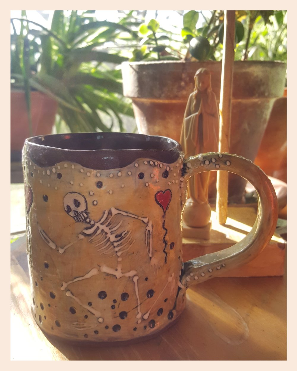 This is an amazing skeleton tea cup from  Sandra Civitarese of Pigasus Art Studio