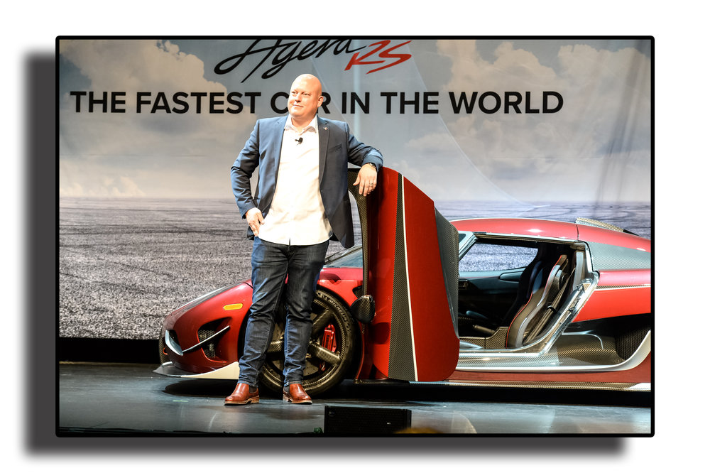 - Christian Von Koenigsegg posing with his company's flagshipvehicle Agera RS