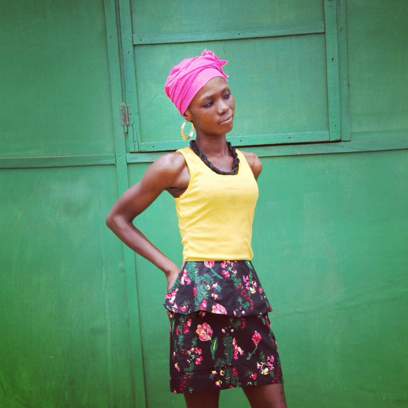 AFIA black floral peplum skirt on location   Arts Centre, Accra, Ghana