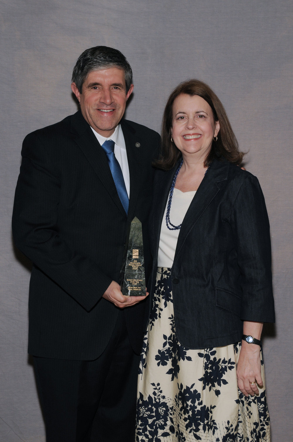 The Gormans with one of their many national awards from the Manufactured Housing Institute