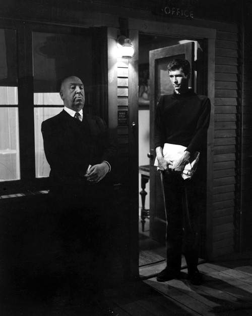 theregoesmygun :     On the set of Psycho, Alfred Hitchcock shows Anthony Perkins how to look menacing (1960)