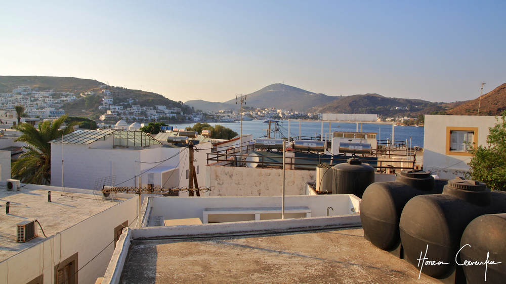 Here's also a view of the Patmos harbour over the rooftops.  Note the black tanks in the lower right corner--virtually every house in Greece has one (or three by the looks of it).  Go green energy!