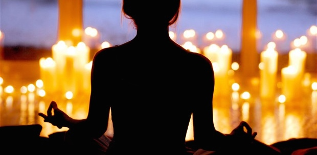 "After stretching in bed I hit the floor for ""morning mind."" Since it is dark when I rise I always light a candle and sit quiet for a few minutes to collect my morning thoughts and give thanks. Photo via Pinterest."