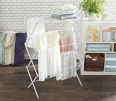 "What a lovely laundry space...wish it were mine, but it's not. I bought pop up racks from  Target  for everyone in my house so we can ""line dry"" or dry flat when needed"