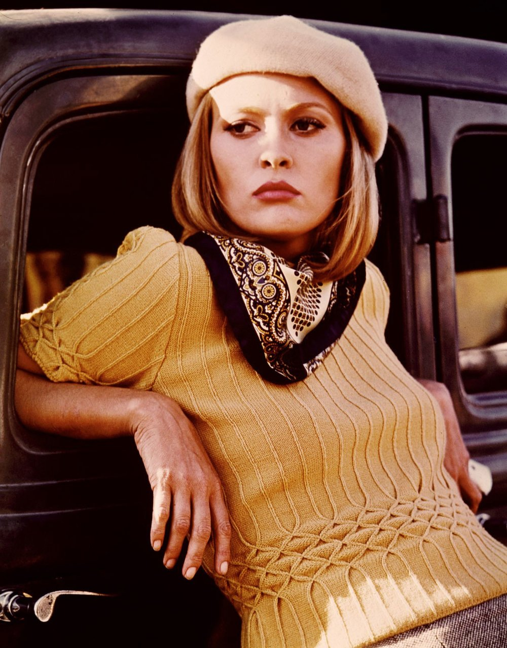 Faye Dunaway in Bonnie and Clyde. That sweater is everything paired with the scarf and beret or tam.