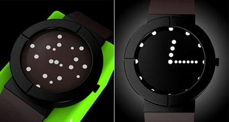 "from  travors :    The OLED TIWE. It normally displays a bunch of little white balls (""stars"") randomly floating around the face. But when you give it a shake or tap on the glass the balls come together to show the time. (via  OLED ""Star"" Watch, Looks Good, I Want - Geekologie )"