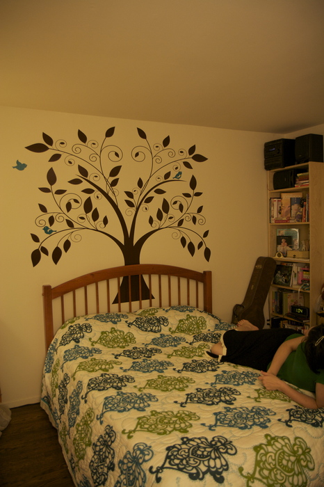 We put up an awesome wall decal from Etsy by BadassCustomDecals and Singlestonestudios.  Instant art/decor and it doesn't ruin the walls, removable but not reusable.  Perfect for apartments.  Marco and I spent all night putting it up.  Much more difficult than expected, but still worth it.